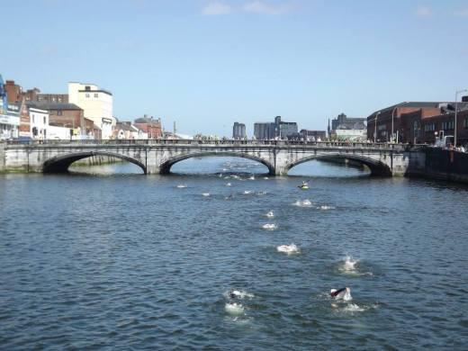 Swimmers swimming through Cork City